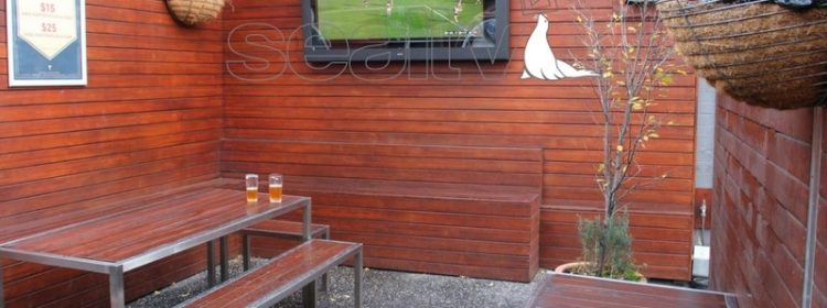Outdoor Television Enclosure mounted to a wall in a pub