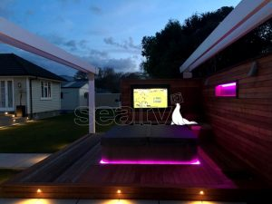 Outdoor Television on a decking with a spa